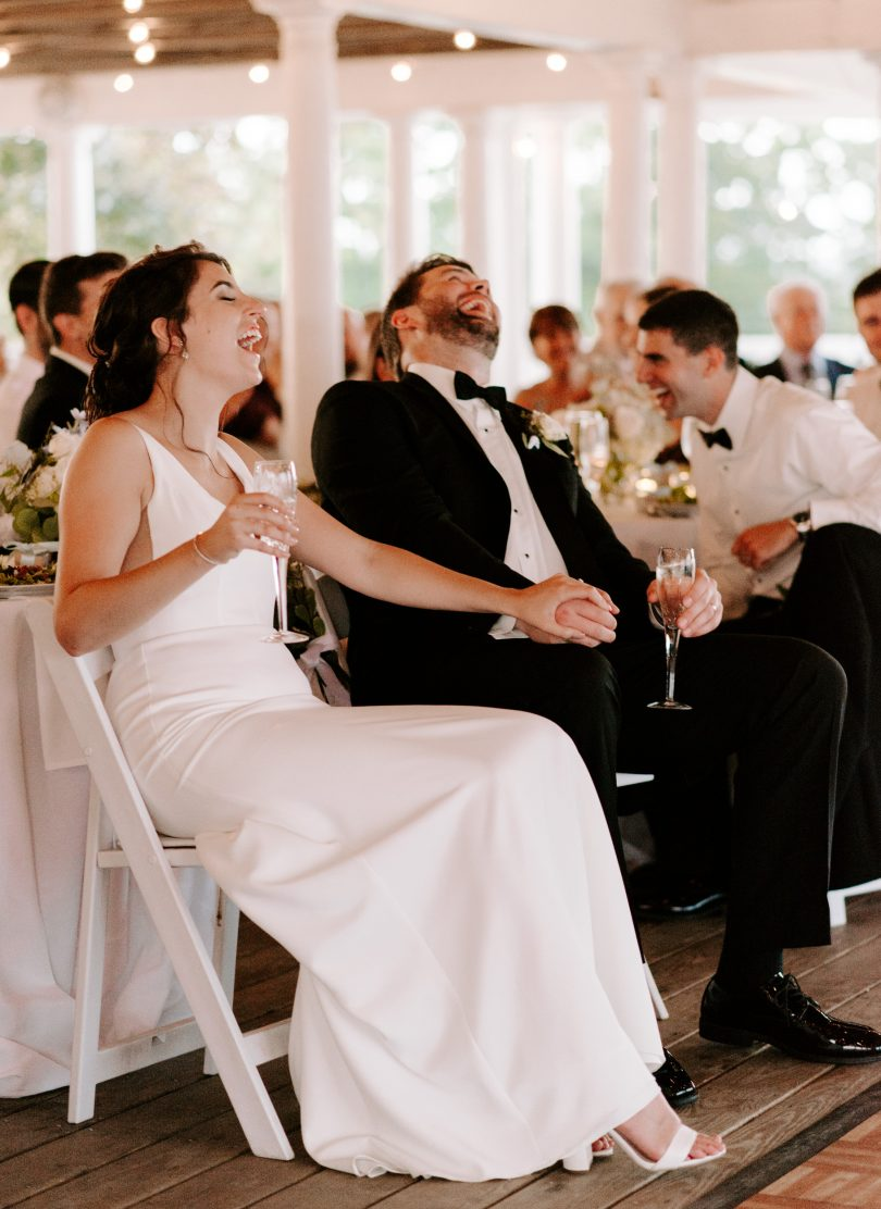 A couple laughing at the best man's speech | Boston wedding photographer